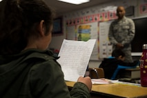 A student from the Kotzebue Elementary School reads a letter she wrote to the service members of Innovative Readiness Training Arctic Care 2018 during a career day at the school to thank them for all they are doing for the Northwest Arctic Borough, Kotzebue, Alaska, April 19, 2018.