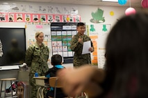 Marine Corps Cpl. Chandarong Ouk, an embarkation specialist with 4th Medical Battalion, 4th Marine Logistics Group, talks with students during a career day at the Kotzebue Elementary School, Kotzebue, Alaska, April 19, 2018.