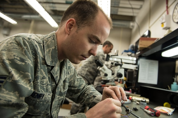 U.S. Air Force Staff Sgt. Brandon Henry, front, and Staff Sgt. Alexander Creznic, 20th Maintenance Group Air Force Repair Enhancement Program technicians, work on weight and balance kit cables at Shaw Air Force Base, S.C., April 20, 2018.