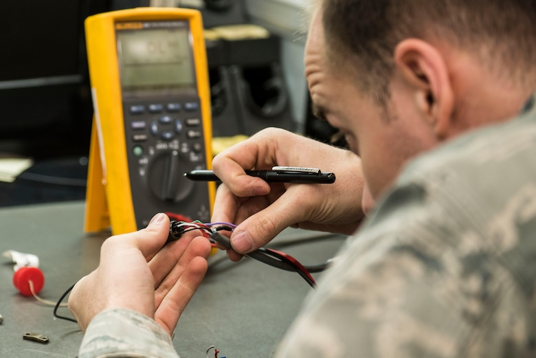 U.S. Air Force Staff Sgt. Brandon Henry, 20th Maintenance Group Air Force Repair Enhancement Program technician, performs preventative maintenance on a weight and balance kit cable at Shaw Air Force Base, S.C., April 20, 2018.