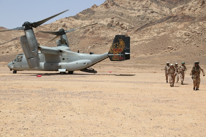 U.S. Marines with the 26th Marine Expeditionary Unit (MEU) exit an MV-22B Osprey to observe training events as part of exercise Eager Lion, Al Quwayrah, Jordan, April 19, 2018. Eager Lion is a capstone training engagement that provides U.S. forces and the Jordan Armed Forces an opportunity to rehearse operating in a coalition environment and to pursue new ways to collectively address threats to regional security and improve overall maritime security.  (U.S. Marine Corps photo by Gunnery Sgt. Eric L. Alabiso II/Released)