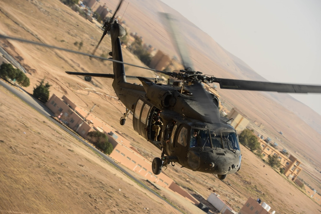 The 1st Battalion, 126th Aviation Regiment, Charlie Company and the 1st Battalion, 244th Aviation Regiment, Assault Helicopter Battalion conduct a medical evacuation validation for Exercise Eager Lion 2018 from King Abdullah II Air Base in Az-Zarqa, Jordan, April 14, 2018. Eager Lion is a major Exercise with the Hashemite Kingdom of Jordan, designed to exchange military expertise and improve interoperability among partner nations. (US Air Force photo by Master Sgt. Joshua L. DeMotts)