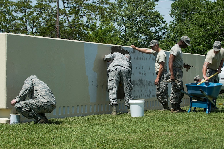 Members of the 307th Civil Engineer Squadron work to complete a makeover of the 307th Bomb Wing headquarters sign on April 11, 2018, Barksdale Air Force Base, La.