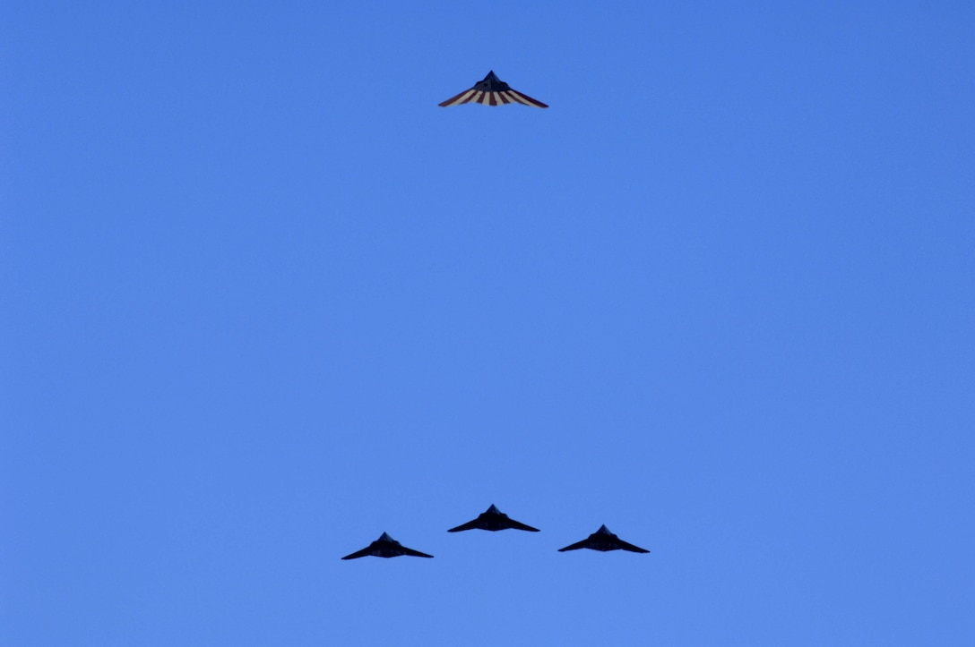 Four F-117A Nighthawk's perform one last flyover at the Sunset Stealth retirement ceremony at Holloman AFB, N.M., April 21, 2008. The F-117A flew under the flag of the 49th Fighter Wing at Holloman Air Force Base from 1992 to its retirement in 2008. (U.S. Air Force photo by Staff Sgt. Jason Colbert)