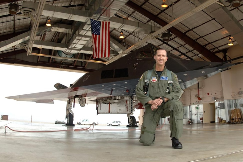 Retired Air Force Col. Jack Forsythe in front of the flag F-117 at Tonopah Air Force Base, Nev., after the last mission April 22, 2008. Forsythe led the four-ship formation that flew the Nighthawk to its resting place. (Courtesy photo)