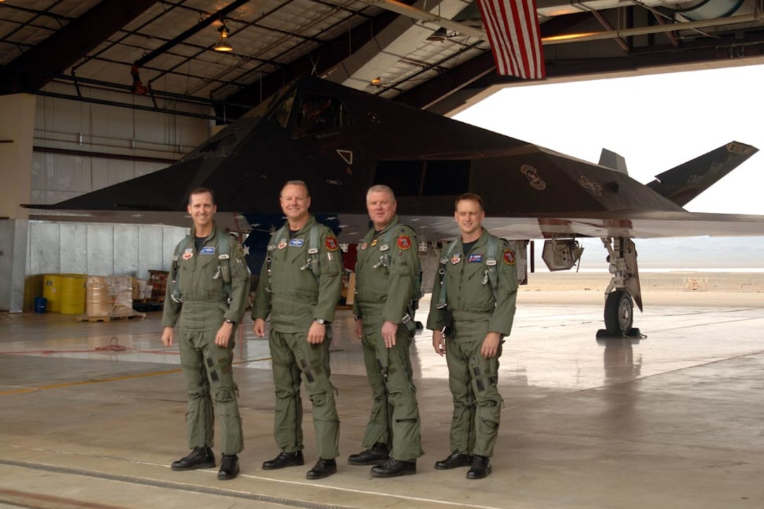 From left: retired Col. Jack Forsythe, Lt. Col. Mark Dinkard, 49th Operations Group deputy, Lt. Col. Todd Flesch, 8th Fighter Squadron commander, Lt. Col. Ken Tatum, 9th Fighter Squadron commander, after retiring the last four F-117s to Tonopah Air Force Base, Nev. April 22, 2008. (Courtesy photo)