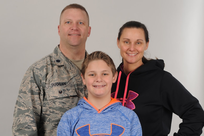 From left, Lt. Col. Jerrod Duggan, 341st Maintenance Group vice commander, his son Mason, and wife Kimberly, pose for a portrait April 2, 2018, at Malmstrom Air Force Base, Mont.