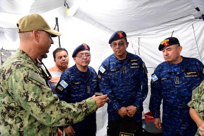 Military medical officials talk.