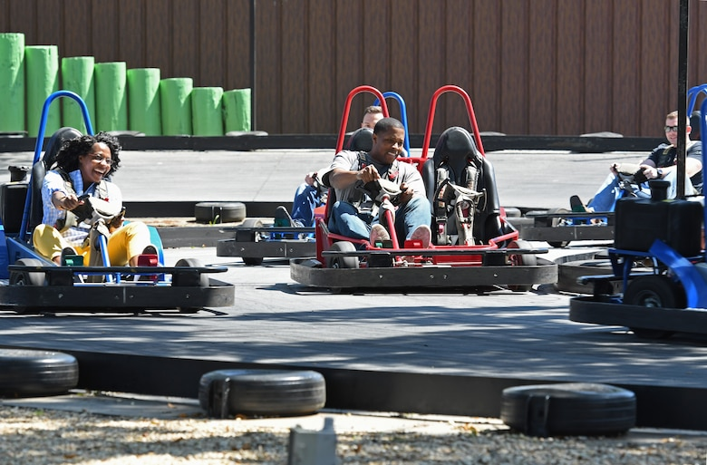 Members of the 81st Training Wing commander's support staff ride go-carts for Dragon Chat at Big Play in Biloxi, Mississippi, April 19, 2018. Dragon Chat consisted of Airmen participating in small group discussions within their units to focus on building resiliency and team building initiatives. (U.S. Air Force photo by Kemberly Groue)