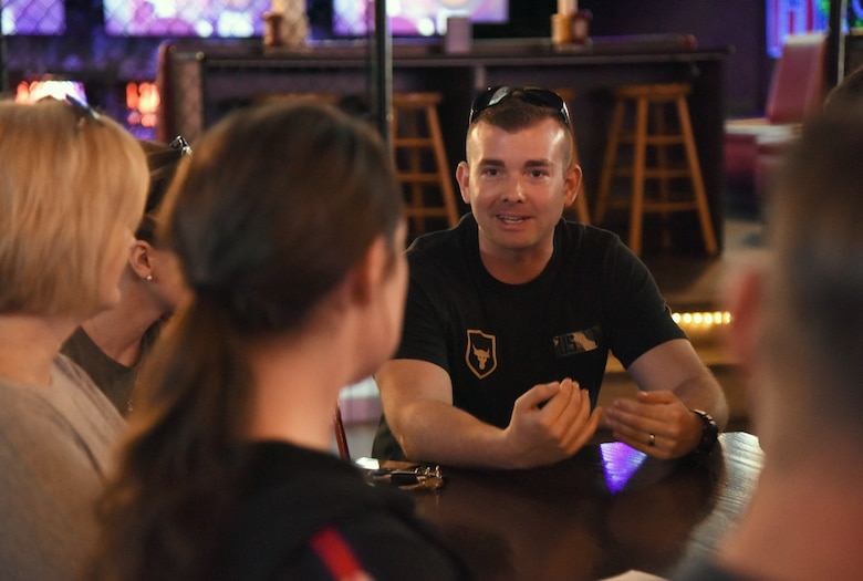 Second Lt. Joshua Field, 333rd Training Squadron student, and the 81st Training Wing commander's support staff have a discussion during Dragon Chat at Big Play in Biloxi, Mississippi, April 19, 2018. Dragon Chat consisted of Airmen participating in small group discussions within their units to focus on building resiliency and team building initiatives. (U.S. Air Force photo by Kemberly Groue)