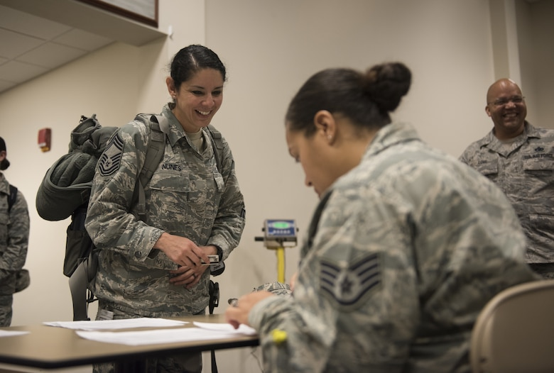 U.S. Air Force Chief Master Sgt. Sandra Nunes, 81st Medical Operations Squadron superintendent, in processes at the Roberts Consolidated Aircraft Maintenance Facility at Keesler Air Force Base, Mississippi, April 16, 2018. Ninety-nine Airmen from the 81st Medical Group traveled to Indiana to help set up a medical facility in support of Joint Task Force Civil Service. More than 3,200 Defense Department and civilian medical personnel are participating in the operation. (U.S. Air Force photo by Senior Airman Holly Mansfield)