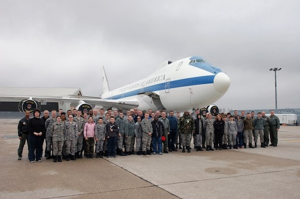 Members of the Civil Air Patrol gather outside an E-4B for a group photo as part of their Aerospace Education Day hosted by units assigned to Offutt AFB and the Gen. Curtis E Lemay, Offutt Composite Squadron at Offutt Air Force Base, Neb. March 24, 2018.