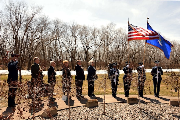 Col. Jeremy Thiel, 319th Air Base Wing vice commander, stands beside the Grand Forks Air Force Base Ambassadors at a bench dedication ceremony April 20, 2018, on Grand Forks AFB, N.D. The ceremony honored of the late Marijo Shide, a fellow ambassador who passionately served her community. (Air Force photo by Airman 1st Class Elora J. Martinez)