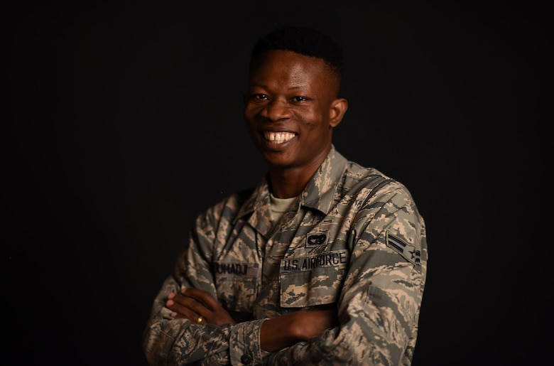 Airman 1st Class Kofi Combey Douhadji, 92nd Logistics Readiness Squadron vehicle operator, poses for a photo at Fairchild Air Force Base, Washington, April 17, 2018. Douhadji and his family participated in the online Diversity Visa Lottery Program and were selected by the program to immigrate to the U.S with a 10-year visa. Six months after arriving in the U.S., Douhadji enlisted in the U.S. Air Force. (U.S. Air Force photo/Airman 1st Class Jesenia Landaverde)