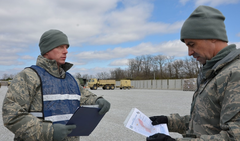 Capt. Lee Laughridge, Air Forces Northern Medical Operations and Training chief, discusses the exercise scenario with Lt. Col. Jack Vilardi, 81st Medical Group operations officer, during the Expeditionary Medical Support field confirmation exercise at Camp Atterbury, Indiana, April 17, 2018. The confirmation exercise evaluated the tactics, techniques and procedures of EMEDS operations during a domestic U.S. contingency such as a natural disaster. (U.S. Air Force photo by Mary McHale)