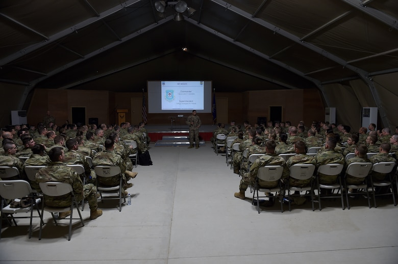 Col. Gonzales speaks to more than 100 Airmen in a large tent