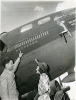 Margaret Polk with Robert Morgan in front of the Memphis Belle.
