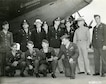"Memphis Belle crew at their first stop on the war bond tour, Washington, DC, on June 16, 1943.  Commanding General of the USAAF Henry ""Hap"" Arnold (standing, second from the right) and Undersecretary of War Robert Patterson (standing, third from left) are pictured with them."