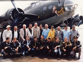 A 1990 fictionalized Hollywood movie produced by Wyler's daughter Catherine added to their fame.  Here Memphis Belle crewmen are pictured with the actors who portrayed them, in front of a B-17 painted to resemble the Memphis Belle. (Courtesy of the Memphis Belle Memorial Association)