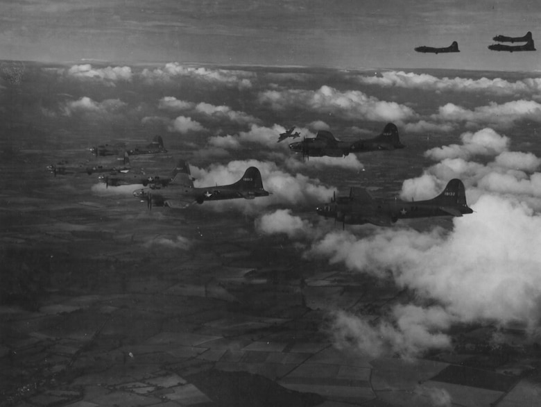 On August 17, 1942, twelve B-17Es struck the railroad marshalling yards at Rouen-Sotteville in France, marking the first Eighth Air Force heavy bomber raid.  Many of the aircraft used on this first raid are seen here on a training exercise over England.