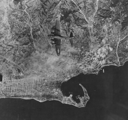 B-17 bombing the port at Messina, Sicily.