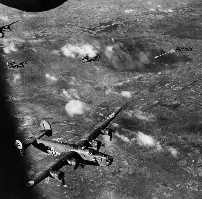 B-24s bomb Diepholz airfield in Germany—this important air base was hit several times during Big Week.