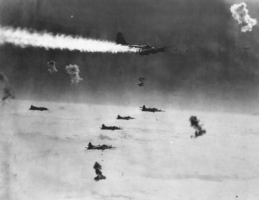 Despite being on fire and surrounded by flak bursts, this B-17 stayed in formation to drop its bombs on Berlin.  The bombers were most vulnerable on the bomb run, when they had to fly straight and level for several minutes to ensure accuracy.