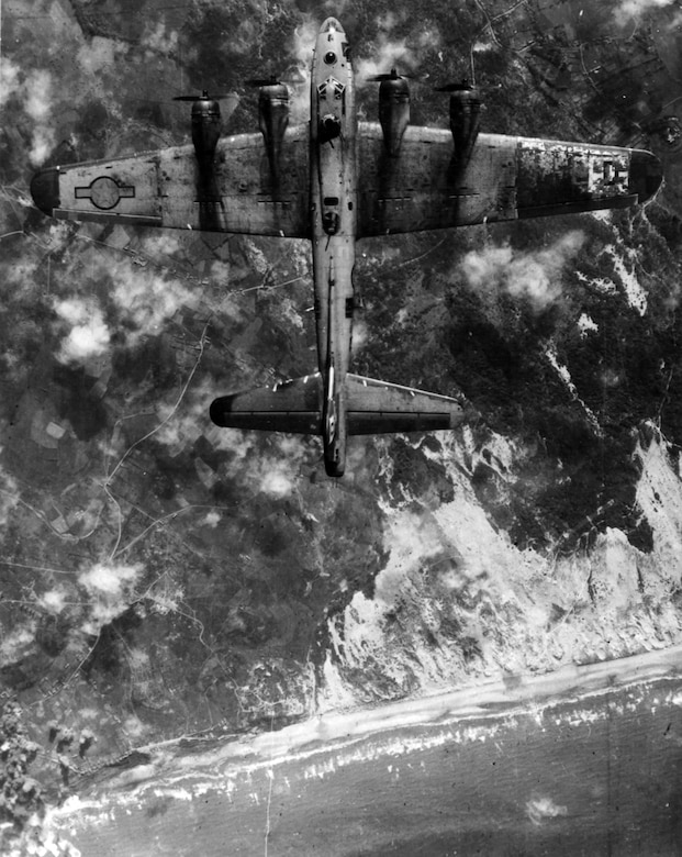 The day before the invasion, heavy bombers pounded enemy coastal defenses far north of the actual beaches.  This was part of a successful trick to make the German defenders believe the landing would be in a different place.