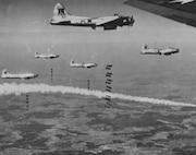 Eighth Air Force B-17s bombing the railroad yards in Donauworth, Germany, in April 1945.  The smoke is from a marker signaling the bomb drop.