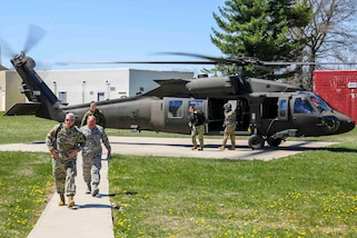 Army Maj. Gen. Richard Gallant, commander, Joint Task Force Civil Support (JTF-CS), departs a HH-60 Blackhawk with his command group at Muscatatuck Urban Training Center, Ind. Apr 20, 2018. JTF-CS is currently engaged in exercise Vibrant Response, an annual exercise that tests JTF-CS's and the Defense Chemical, Biological, Radiological and Nuclear Response Force (DCRF)'s ability to respond to a catastrophic event. JTF-CS provides command and control for designated Department of Defense specialized response forces to assist local, state, federal and tribal partners in saving lives, preventing further injury and providing critical support to enable community recovery. (U.S. DoD photo by Mass Communication Specialist 3rd Class Michael Redd/released)