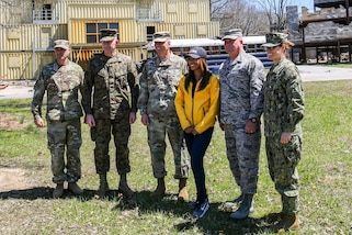 Army Maj. Gen. Richard Gallant, commander, Joint Task Force Civil Support (JTF-CS), and his command group pose for a photo with ABC11 Eyewitness News reporter Morgan Norwood at Muscatatuck Urban Training Center, Ind. Apr 20, 2018. JTF-CS is currently engaged in exercise Vibrant Response, an annual exercise that tests JTF-CS's and the Defense Chemical, Biological, Radiological and Nuclear Response Force (DCRF)'s ability to respond to a catastrophic event. JTF-CS provides command and control for designated Department of Defense specialized response forces to assist local, state, federal and tribal partners in saving lives, preventing further injury and providing critical support to enable community recovery. (U.S. DoD photo by Mass Communication Specialist 3rd Class Michael Redd/released)