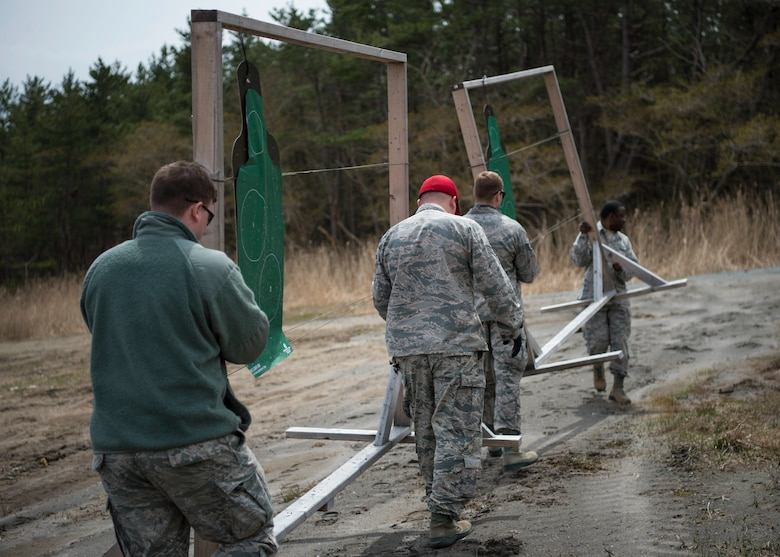 Members with the 35th Security Forces Squadron and 35th Aerospace Medicine Squadron move practice targets from the new Combat Arms Training and Maintenance outdoor firing range at Draughon Range adjacent Misawa City, Japan, April 18, 2018. Conceptualized nearly three years ago, the outdoor range provides CATM six times more space to qualify Airmen on a variety of weapons. The current indoor range can qualify seven Airmen at one time, where the outdoor range serves 40. (U.S. Air Force photo by Staff Sgt. Deana Heitzman)