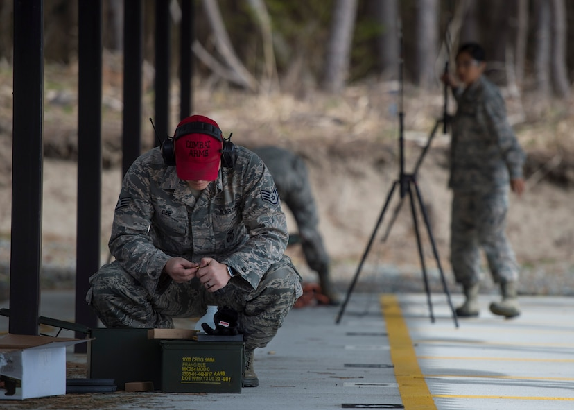 U.S. Air Force Staff Sgt. Tyler Bee, the 35th Security Forces Squadron assistant combat arms NCO in charge, loads an M4 carbine magazine prior to conducting a hazardous noise test at the new Combat Arms Training and Maintenance outdoor firing range at Draughon Range adjacent Misawa City, Japan, April 18, 2018. In order to certify, the outdoor range must undergo additional inspections by the 35th Civil Engineer Squadron and the 35th Fighter Wing safety office. (U.S. Air Force photo by Staff Sgt. Deana Heitzman)