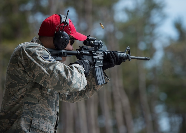 U.S. Air Force Staff Sgt. Tyler Bee, the 35th Security Forces Squadron assistant combat arms NCO in charge, shoots an M4 carbine during a hazardous noise test at the new Combat Arms Training and Maintenance outdoor firing range at Draughon Range adjacent Misawa City, Japan, April 18, 2018. Members from the 18th Aerospace Medicine Squadron bioenvironmental engineering unit from Kadena Air Base, Japan, conducted tests to certify the outdoor range for final inspections. (U.S. Air Force photo by Staff Sgt. Deana Heitzman)
