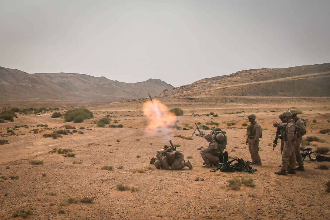 U.S. Marines assigned to Fox company, Battalion Landing Team, 2nd Battalion, 6th Marine Regiment (BLT 2/6), 26th Marine Expeditionary Unit (MEU), fire an M224A1 60MM mortar system during exercise Eager Lion in Al Quwayrah, Jordan, April 21, 2018. Eager Lion is a capstone training engagement that provides U.S. forces and the Jordan Armed Forces an opportunity to rehearse operating in a coalition environment and to pursue new ways to collectively address threats to regional security and improve overall maritime security. (U.S. Marine Corps photo by Cpl. Austin Livingston)