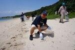DLA Energy Okinawa employees pick up trash from White Beach