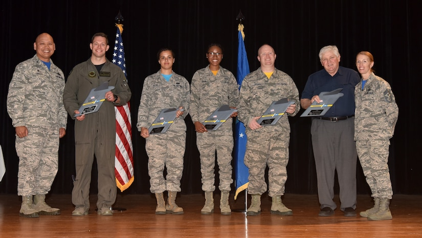 Col. Jimmy Canlas, left, 437th Airlift Wing commander, and Chief Master Sgt. Jennifer Kersey, right, 437th AW command chief, stand with 1st Quarter Award winners during a ceremony April 20, at Joint Base Charleston, S.C.