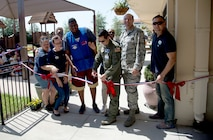 U.S. Air Force Col. Troy Pananon, center, vice commander of the 6th Air Mobility Wing, cuts the ribbon at an opening ceremony for a new playground at Child Development Center 3, April 20, 2018 at MacDill Air Force Base, Fla.
