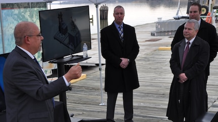 """IMAGE: DAHLGREN, Va. (March 28, 2018) - John Fiore, Naval Surface Warfare Center Dahlgren Division (NSWCDD) technical director, addresses government, defense contractors and military personnel at a demonstration of NSWCDD-developed weapon technologies and Textron Systems' developmental Common Unmanned Surface Vehicle (CUSV). The autonomous Navy weapons systems - known as the Surface and Expeditionary Warfare Mission Module - are to be integrated as a proof of concept with the autonomous CUSV. """"Our partnerships with industry allow us to move fast,"""" said Fiore. """"If you're the one that's going to be giving this capability to warfighters, I want you to be effective in doing that. That's what motivates us and that's why we collaborate. That's why it's so important for us to have you here today with your equipment and have you partnering with us."""" (U.S. Navy photo/Released)"""