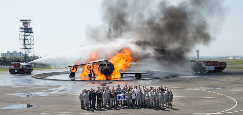"Entertainers pose for a photo with members of the the 374th Civil Engineer Squadron at Yokota Air Base, Japan; the first stop on the annual Vice Chairman's USO Tour, April 22, 2018. Comedian Jon Stewart, country music artist Craig Morgan, celebrity chef Robert Irvine, professional fighters Max ""Blessed"" Holloway and Paige VanZant, and NBA Legend Richard ""Rip"" Hamilton will join Gen. Selva on a tour across the world as they visit service members overseas to thank them for their service and sacrifice."