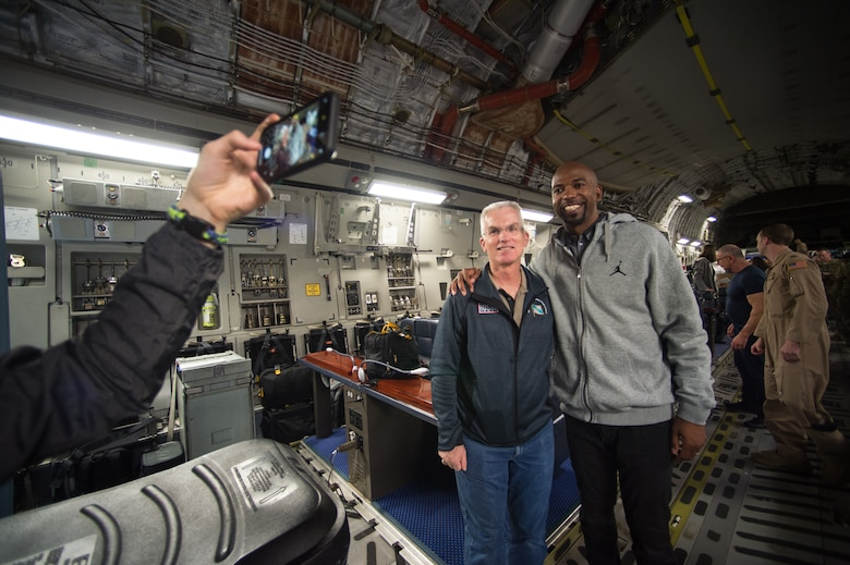 "U.S. Air Force Gen. Paul J. Selva, Vice Chairman of the Joint Chiefs of Staff, poses for a photo with NBA Legend Richard ""Rip"" Hamilton board a C-17 aircraft before departing on the annual Vice Chairman's USO Tour, April 20, 2018 at Joint Base Andrews, Md. Comedian Jon Stewart, country music artist Craig Morgan, celebrity chef Robert Irvine, professional fighters Max Holloway and Paige VanZant, and NBA Legend Richard ""Rip"" Hamilton will join Gen. Selva on a tour across the world as they visit service members overseas to thank them for their service and sacrifice."