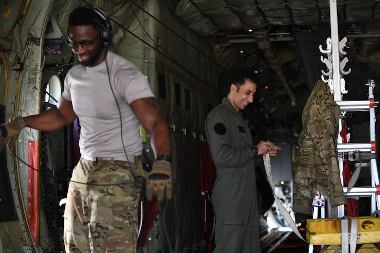 U.S. and Moroccan loadmasters work on a C-130J