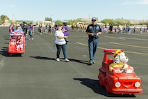 Steve Nelson, MTD Specialist, operates Sparky, the symbol of fire prevention to children, during the Month of the Military Child Parade on Marine Corps Logistics Base Barstow, Calif., April 18.