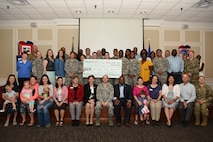Team Shaw volunteers pose for a group photo during an annual volunteer recognition ceremony at Shaw Air Force Base, S.C., April 19, 2018.