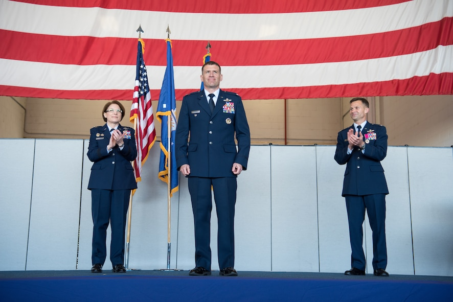 Maj. Gen. Mary O'Brien, 25th Air Force commander, and Col. Larry Broadwell, former 9th Reconnaissance Wing commander, clap for Col. Andrew Clark, 9th RW commander, during the change of command at Beale Air Force Base, California, April 13, 2018. Clark will be responsible for more than 7,000 Airmen and civilians as well as the Air Force's entire high-altitude reconnaissance fleet of RQ-4 Global Hawk and U-2 Dragon lady aircraft.