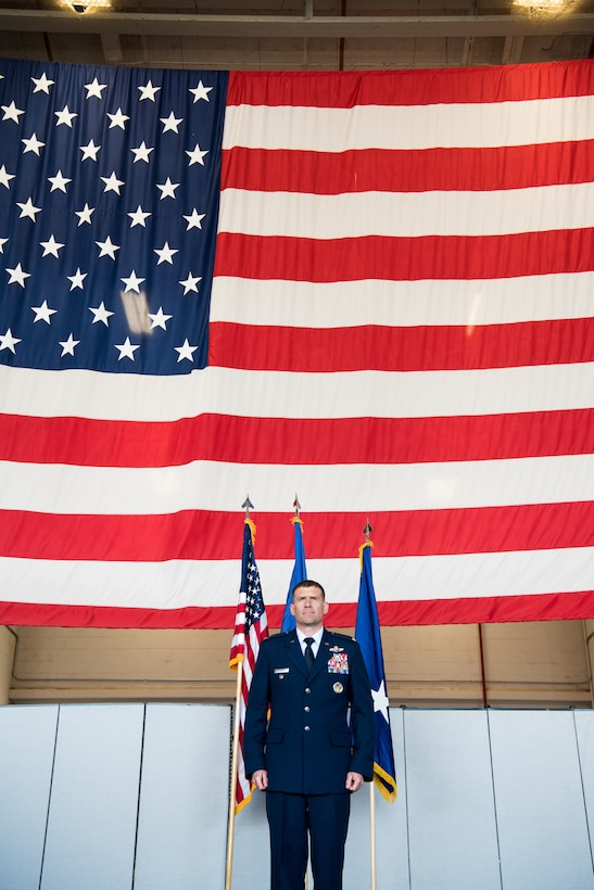 Col. Andrew Clark, 9th Reconnaissance Wing commander, stands at attention awaiting his first salute as the new commander of the 9th RW Beale Air Force Base, California, April 13, 2018. The 9th RW is the only intelligence, surveillance and reconnaissance wing in the Department of Defense.