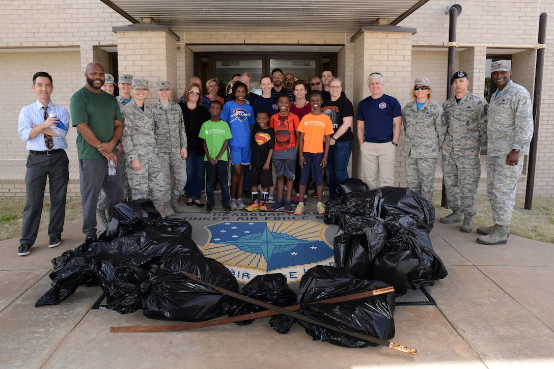 Members of the 72nd Air Base Wing pose with several bags of trash they picked up from the area around the ABW Headquarters. 72ABW Commander Col. Kenyon Bell, far right, encourages everyone to do their part in keeping the installation clean and well-kept and take pride in Tinker every day.