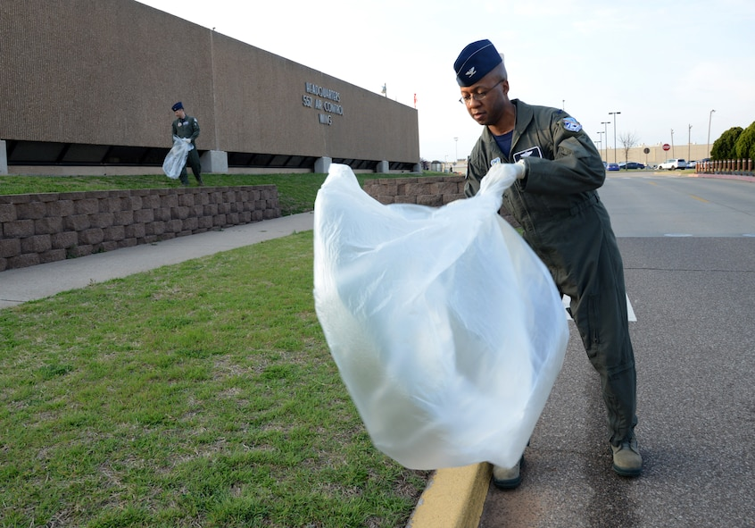 552nd Air Control Wing Commander Col. Geoffrey Weiss, left, and Vice Commander Col. Gavin Marks picked-up trash around their headquarters building on Apr. 13 for Tinker Pride Day.