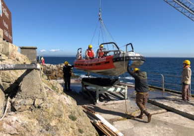 A crew from the U.S. Army Corps of Engineers resupplies scientists on the Farallon Islands, a remote speck of inhospitable land off the coast of San Francisco.