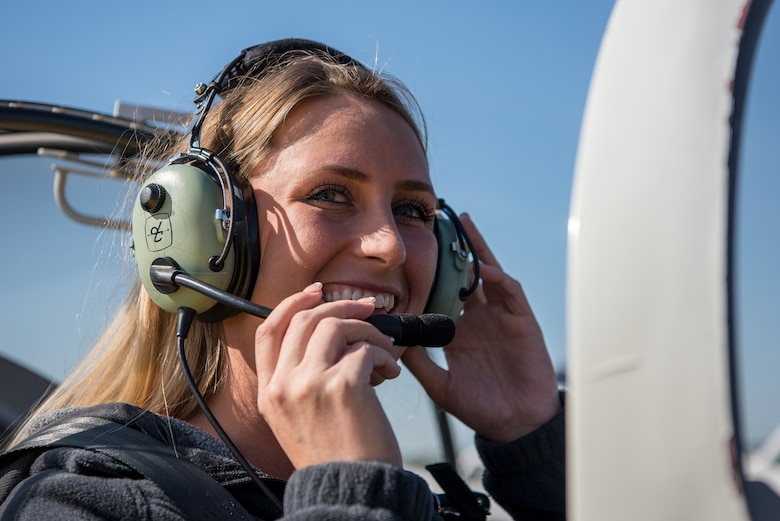 Senior Airman Payton Rossi, 4th Operations Support Squadron air traffic controller, adjusts her headset in preparation for flight during a Controller Appreciation event, April 21, 2018, in Pikeville, North Carolina.
